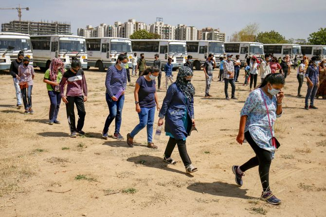 Gujarat students from Kota maintain a physical distance after they arrive in Ahmedabad, April 23, 2020. Photograph: PTI Photo
