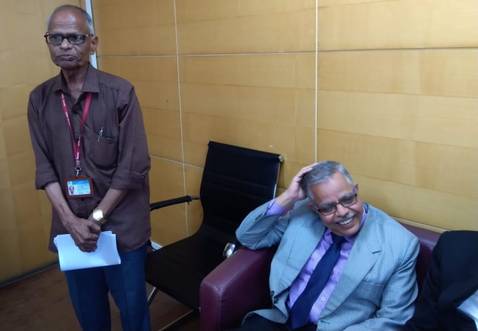Standing: Govind Dingankar, superintendent of the commission; seated: V V Palnitkar, commission secretary