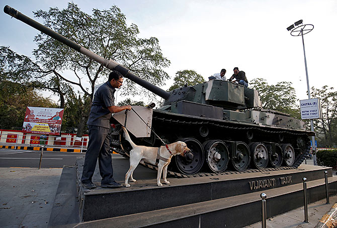 February 18, 2020: The Gujarat police bomb disposal squad scan a tank along the route that United States President Donald J Trump and Prime Minister Narendra Damodardas Modi will take during Trump's visit to Ahmedabad. Photograph: Amit Dave/Reuters