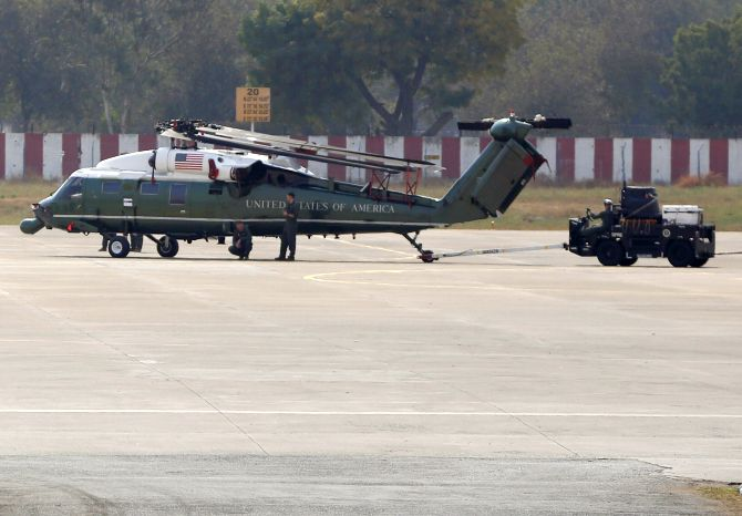 A US Hummingbird helicopter for US President Donald J Trump's visit arrives at Ahmedabad's Sardar Vallabhbhai Patel airport, ferried by a US air force cargo plane.