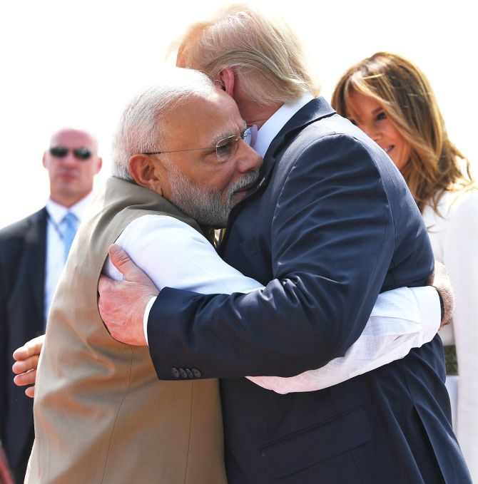 Hugs and dandiya: Modi welcomes Trump to India