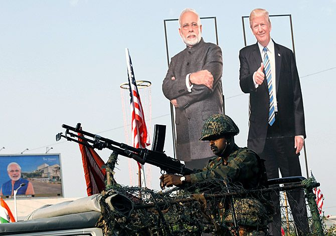 An Indian Army soldier sits atop an armoured vehicle next to cutouts of India's Prime Minister Narendra Damodardas Modi and US President Donald J Trump in Ahmedabad, February 23, 2020. Photograph: Adnan Abidi/Reuters