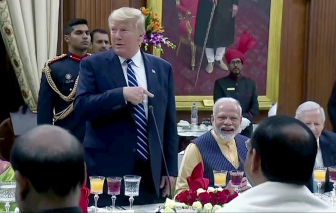 President Donald J Trump makes a point at President Ram Nath Kovind's banquet, which has Prime Minister Narendra Damodasdas Modi chuckling, February 25, 2020