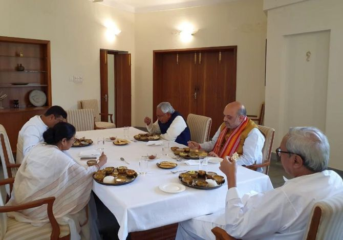 PHOTOS: Shah, Mamata share lunch at Patnaik's home