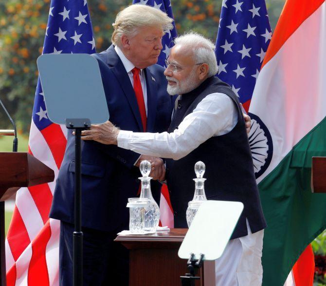 Prime Minister Narendra Damodardas Modi and US President Donald J Trump embrace after talks at Hyderabad House in New Delhi, February 25, 2020. Photograph: Adnan Abidi/Reuters