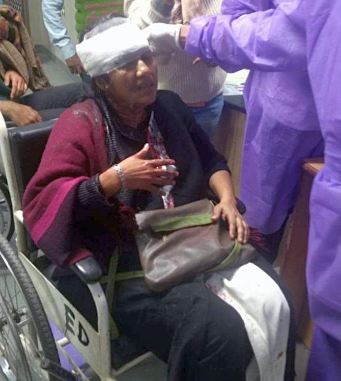 Sucharita Sen, faculty of CSRD JNU, at AIIMS after masked miscreants armed with sticks attacked the JNU campus
