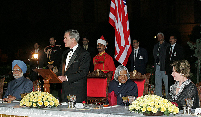 Then US president George W Bush at the State dinner as then prime minister Dr Manmohan Singh, then President A P J Abdul Kalam and then US First Lady Laura Bush look on at Rashtrapati Bhavan, March 2, 2006. Photograph: B Mathur/Reuters