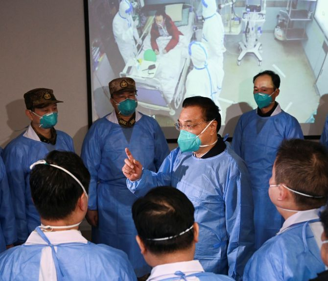 Chinese Premier Li Keqiang wearing a mask and a protective suit speaks to medical workers at the Jinyintan hospital in Wuhan, where patients with coronavirus were being treated. Photograph: cnsphoto via Reuters