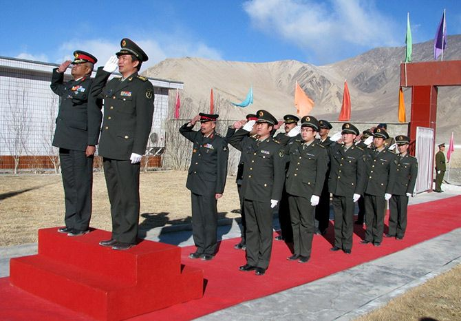 Major General Somnath Jha, left, takes the salute along with his Chinese counterpart after a border personnel meeting in Ladakh. Photograph: Major General Somnath Jha