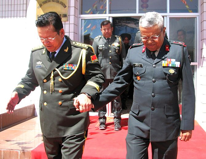 Major Somnath Jha, then the Brigade Commander in Ladakh, with his Chinese counterpart. Photograph: Kind courtesy Major General Somnath Jha