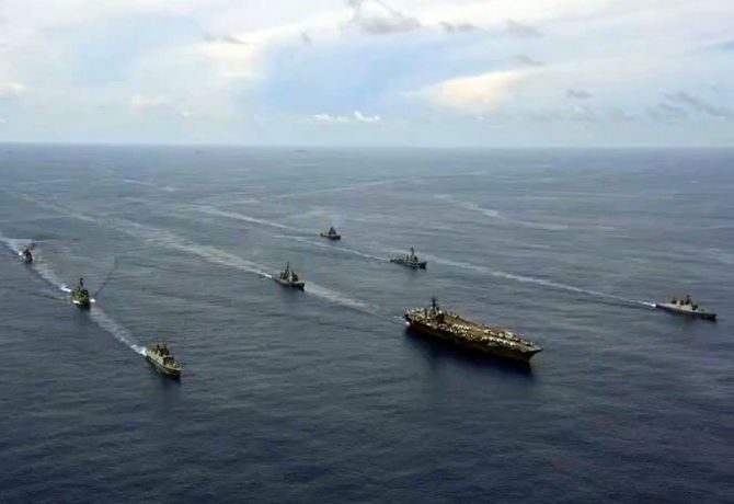 Indian Navy ships conduct a passage exercise with the USS Nimitz