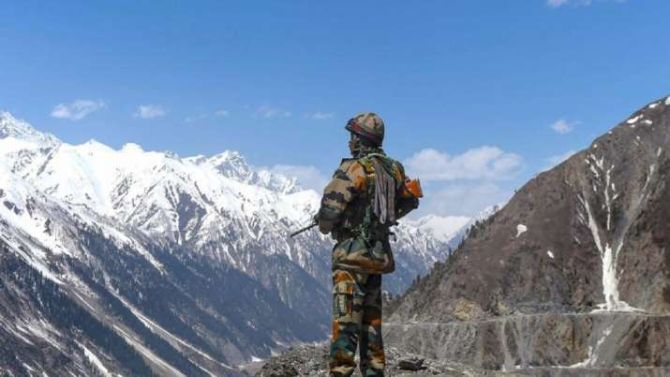 An Indian soldier stands guard in Ladakh. Photograph: PTI Photo