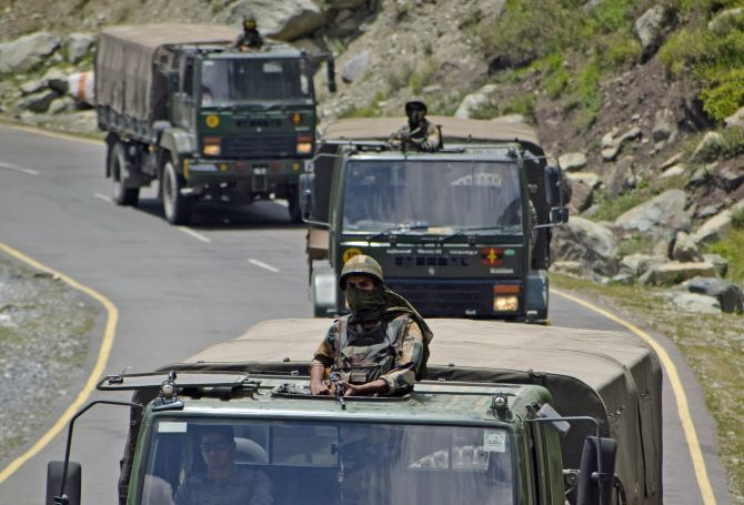 Indian Army trucks move along a highway leading to Ladakh at Gagangeer in Kashmir's Ganderbal district, June 17, 2020. Photograph: Imran Nissar/ANI Photo