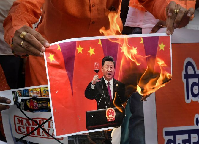 VHP and Bajrang Dal activists burn a poster of Chinese President Xi Jinping in Bhopal after 20 soldiers were killed during the face-off between Indian and Chinese troops in Ladakh. Photograph: PTI Photo