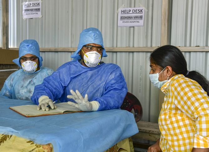 A lady who recently returned from the United States being examined by doctors at a coronavirus help desk at a Hyderabad hospital. Photograph: PTI Photo