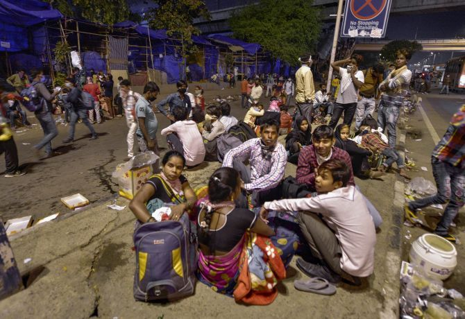 Indians wait for a bus to take them to their villages, March 28, 2020. Photograph: Vijay Verma/PTI Photo