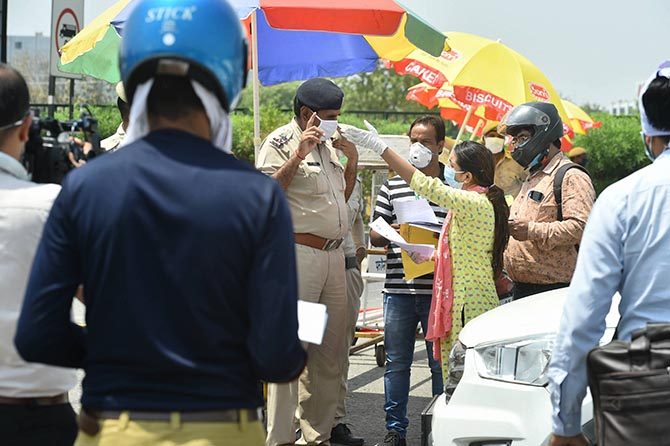 Commuters request police personnel for permission to cross the Delhi-Gurugram border. The border was sealed by the Haryana government on May 1 due to a surge in COVID-19 cases. It will remain shut till further orders.