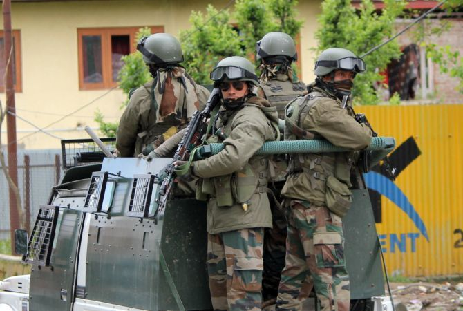 Indian Army soldiers on their way to the operation against terrorists in Handwara, north Kashmir, May 3, 2020. Photograph: Umar Ganie for Rediff.com