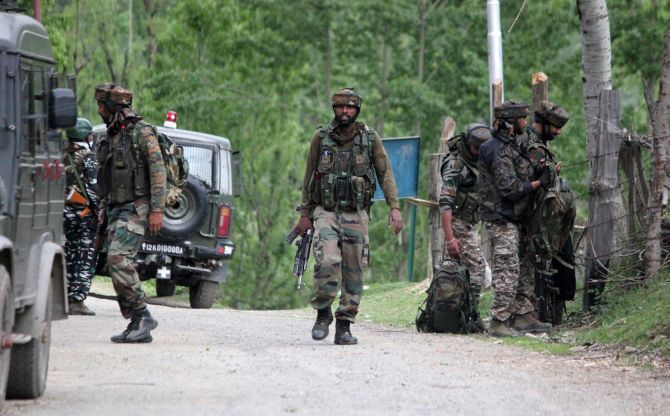 Indian Army soldiers at the end of the operation against terrorists in Handwara, north Kashmir, May 3, 2020. Photograph: Umar Ganie for Rediff.com