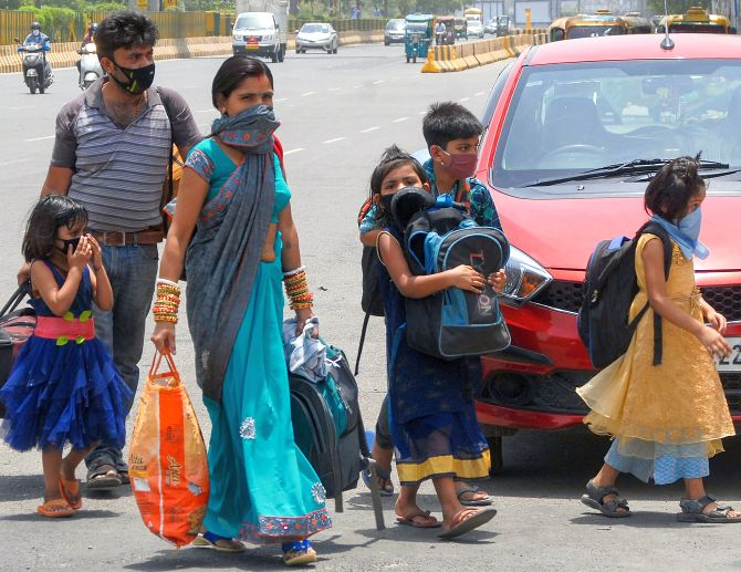 A migrant family look for buses to reach a railway station as they travel towards their native place.