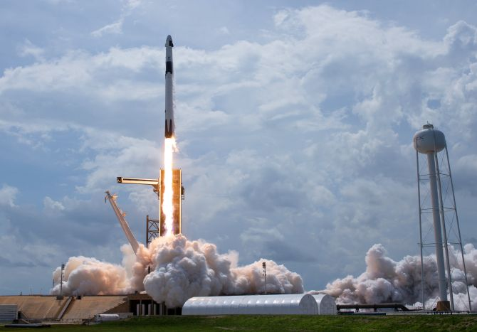 'Historic' SpaceX launches astronauts into orbit