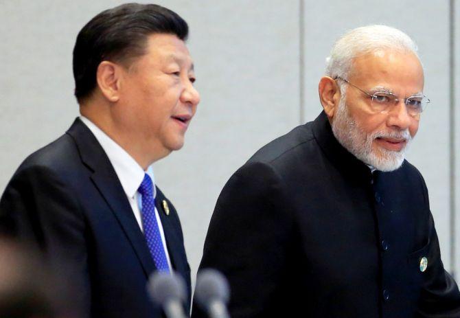 China's President Xi Jinping and India's Prime Minister Narendra Modi