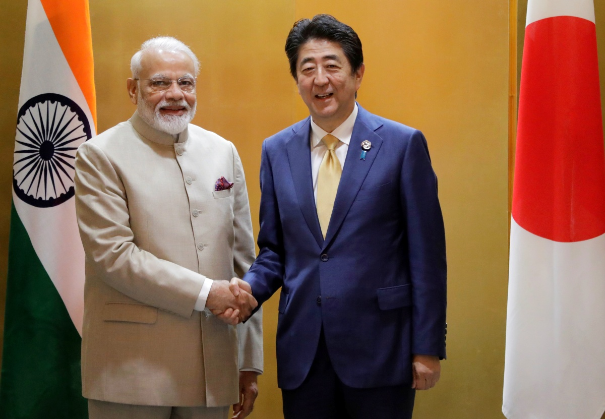 Eyeing China, Japan signs military pact with India