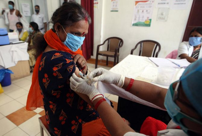 A woman receives a dose of the Covishield vaccine in Prayagraj. Photograph: ANI Photo