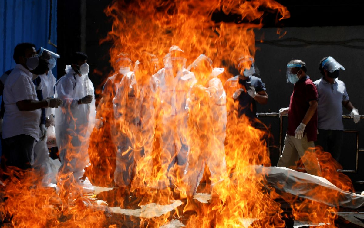 Woman jumps on father's pyre during Covid cremation