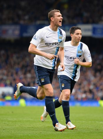 Man City back on top after Dzeko double downs Everton