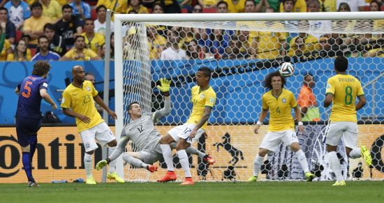 Daley Blind of the Netherlands (L) shoots to score against Brazil