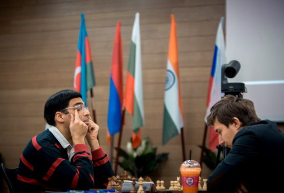 Viswanathan Anand takes a break as his opponent ponders his move.