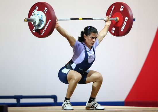 Santoshi Matsa of India lifts in the Women's 53kg Group A Weightlifting at the Scottish Exhibition And Conference Centre