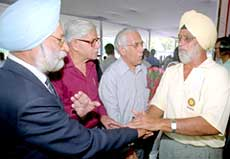 Former Test captain Bishen Singh Bedi chats with some of the Olympians