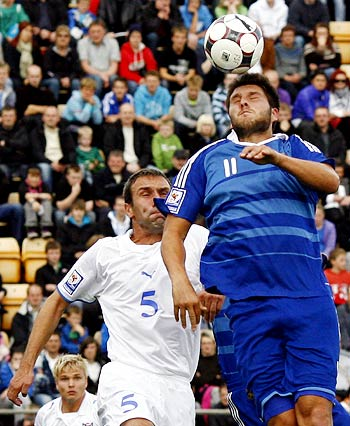 France's Andre-Pierre Gignac (right) heads the ball