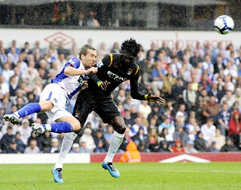 Blackburn Rovers' Gael Givet (left) challenges Manchester City striker Emmanuel Adebayor