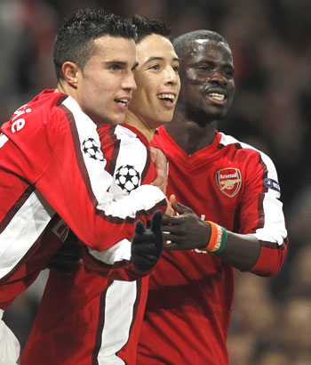Arsenal's Samir Nasri (centre) celebrates with Robin Van Persie (left) and Emmanuel Eboue