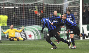 Inter Milan's Ballotelli (second from right) celebrates with Wesley Sneijder after scoring past Rubin Kazan goal-keeper Ryzhikov (in the backgound)