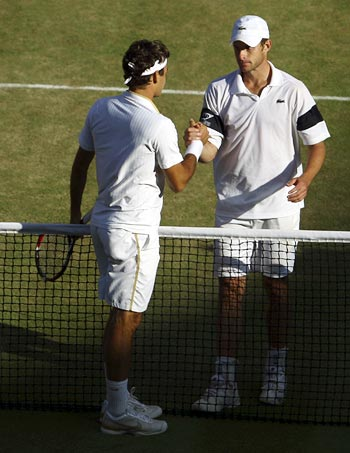 Andy Roddick with Roger Federer