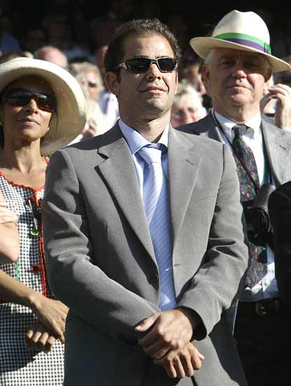 Seven-times Wimbledon champion Pete Sampras watches the presentation after the singles final