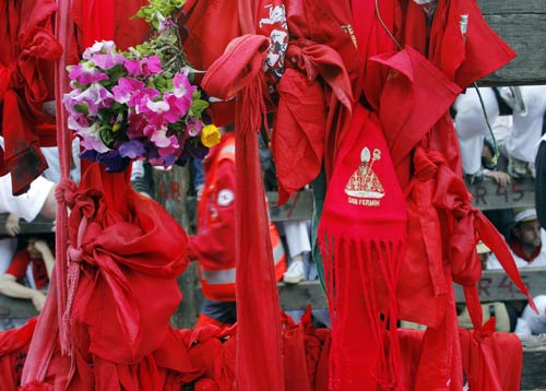 Traditional San Fermin handkerchiefs and scarves are left at the site where Daniel Jimeno was gored to death