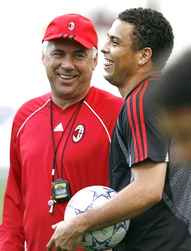 Carlo Ancelotti shares a laugh with Ronaldo