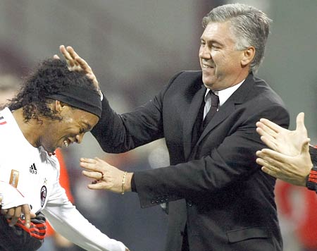 AC Milan's Ronaldinho celebrates with coach Carlo Ancelotti after scoring