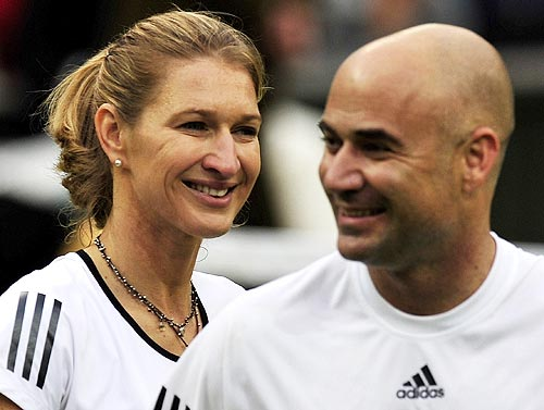 Steffi Graf and husband Andre Agassi smile
