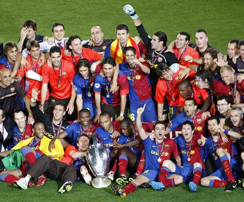 Barcelona players celebrate winning the Champions League final