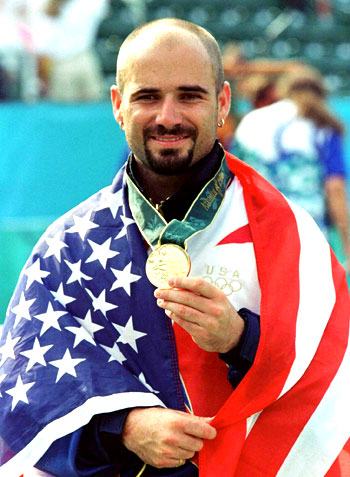 Agassi with his Olympics Gold  medal in 1996