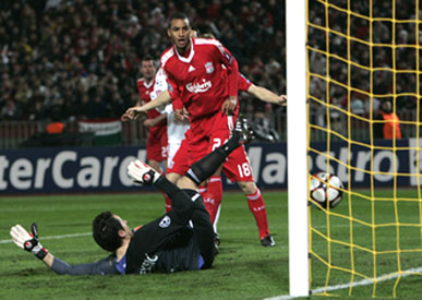 Liverpool's David Ngog (left) scores past Debrecen's 'keeper Vukasin Poleksic at the Puskas stadium in Budapest on Tuesday