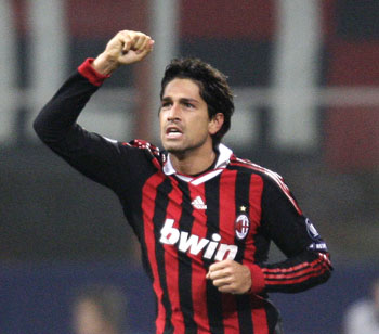 AC Milan's Marco Borriello celebrrates after scoring against Olympique Marseille