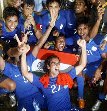 Indian players celebrate winning the Nehru Cup