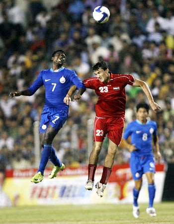 India striker NP Pradeep (left) fights for the ball against Syria's Feras Ismail
